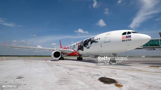 Air Asia's and UFC official partner stickers on the aircraft shot during AirAsia livery event at KLIA 2 on May 25 2018 in Kuala Lumpur Malaysia
