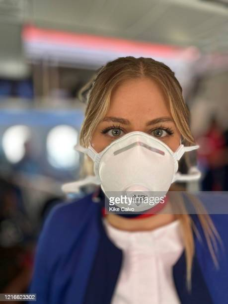 LATAM air attendants use protective gear As countries and airports shut down airlines fly trapped passengers on empty flights before closing...
