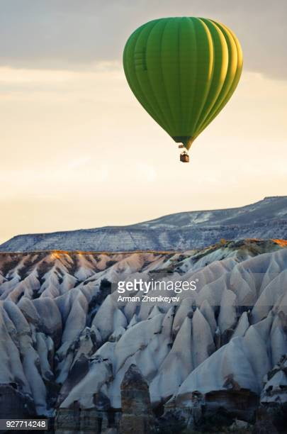 air balloon flying of the cappadocia rocks - hot air balloon stock pictures, royalty-free photos & images