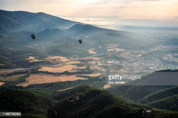 air balloon over volcanic area in la garrotxa, gerona province, catalonia, spain - gerona city stock pictures, royalty-free photos & images