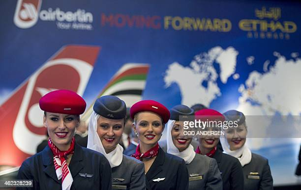 Air Berlin and Etihad airways hostesses pose prior to CEOs of the United Arab Emirates airline carrier Etihad and Air Berlin press conference in...