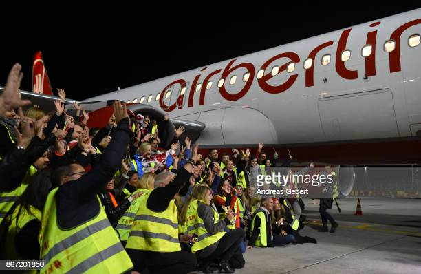 Air Berlin employees take pictures in front of Air Berlin flight AB 6210 before departing for Berlin at Munich International Airport on October 27...