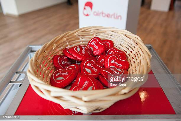 Air Berlin heartshaped chocolates sit in a basket during a news conference at the company's headquarters in Berlin Germany on Tuesday March 4 2014...