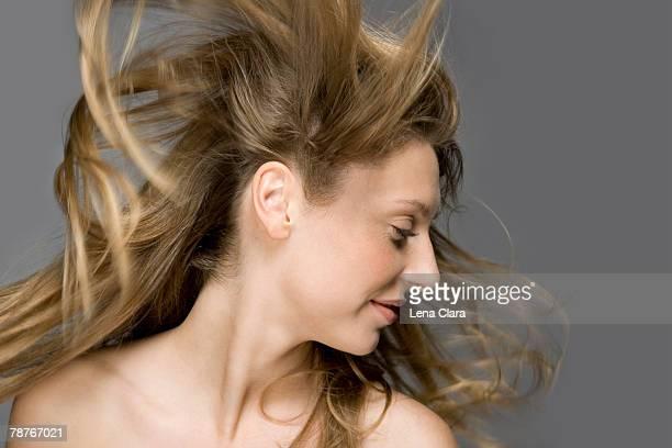 Air blowing through a fashion model's hair