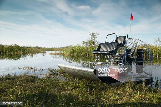 Air boat on bank of creek