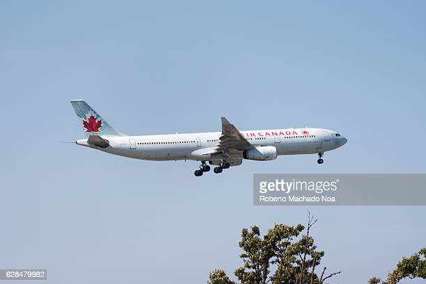 Air Canada airplane in flight There are trees under the plane as it approaches Pearson International Airport