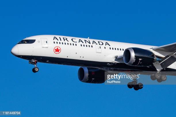 Air Canada Boeing 7879 Dreamliner aircraft landing at London Heathrow International Airport LHR EGLL during a blue sky summer day in England UK on 2...
