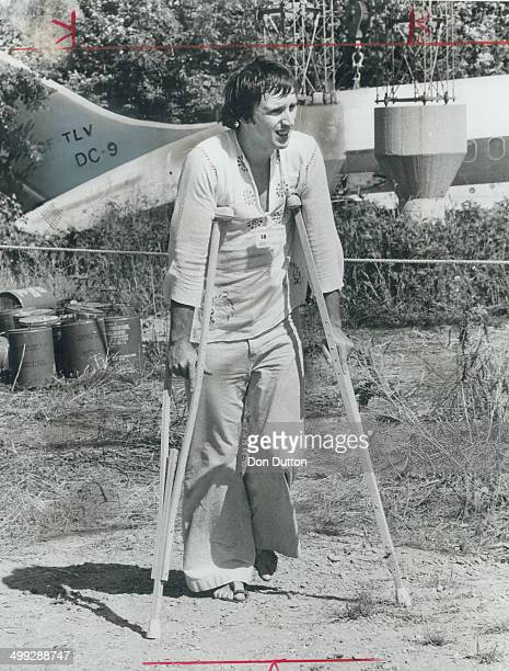 Air Canada flight attendant Richard Begin returns on crutches to the scene of the DC9 crash at Toronto International Airport to alleviate some of my...