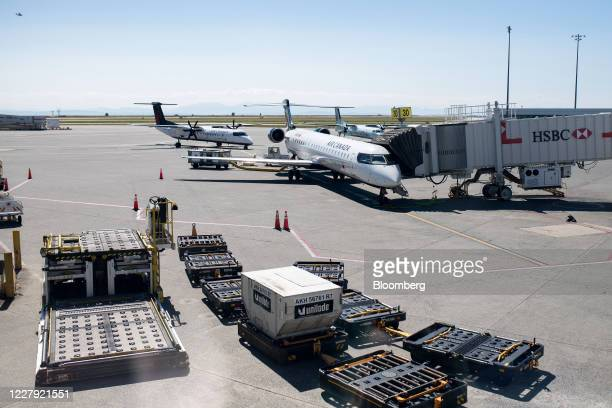 Air Canada planes sit on the tarmac at Vancouver International Airport in Vancouver, British Columbia, Canada, on Tuesday, Aug. 4, 2020. Data from...