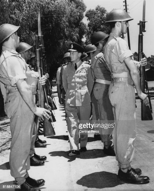 Air Chief Marshal Sir Denis Barnett inspects a Guard of Honour at the training camp of the Cyprus Army near Nicosia Cyprus July 1962 Barnett is the...