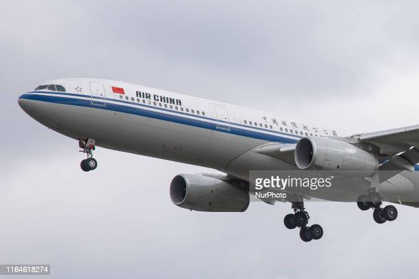Air China Airbus A330300 aircraft on final approach landing at London Heathrow International Airport LHR EGLL in England UK early morning during a...