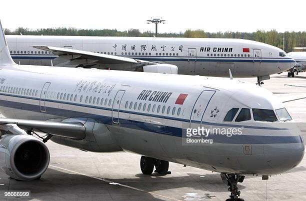 Air China Ltd airplanes are parked at Beijing Capital International Airport in Beijing China on Monday April 26 2010 Air China Ltd the nation's...