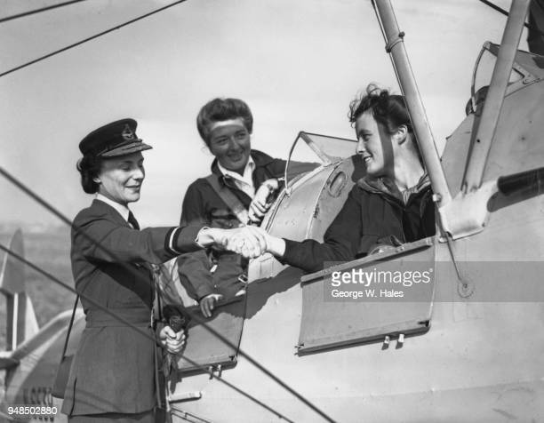 Air Commandant Dame Felicity Hanbury Director of the Women's Auxiliary Air Force congratulates the first two recruits to sign up for the new WAAF...