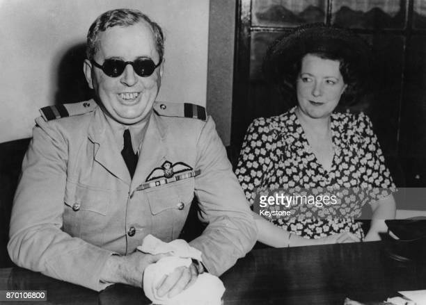 Air Commodore Patrick Huskinson a bomb designer for the RAF attends a press conference in Washington DC with his wife during the United Nations...