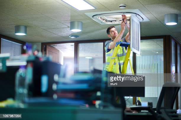 air con maintenance engineer - ventilator stock pictures, royalty-free photos & images