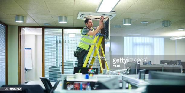 air con maintenance engineer - hvac stock photos and pictures