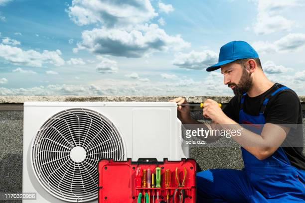 air conditioner installing - air conditioner service - air conditioner stock pictures, royalty-free photos & images