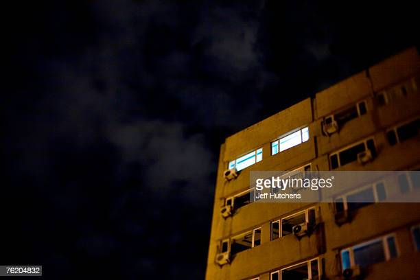 Air conditioner units dot the landscape of a Beijing apartment building providing respite from the heavy air of Beijing summers as buildings old and...
