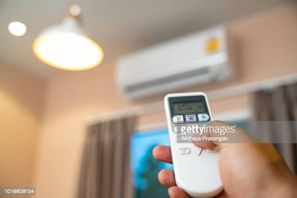 air conditioner with remote controller - hvac stock photos and pictures