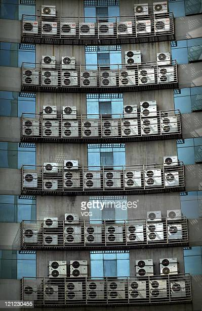 Air conditioners more than 500 in total hang on the wall of an office building on August 15 2011 in Fuzhou Fujiang Province of China This 25story...