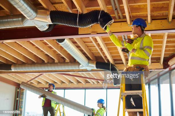 air conditioning duct install - working stock pictures, royalty-free photos & images