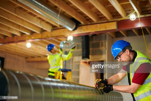air conditioning duct install - headwear stock pictures, royalty-free photos & images