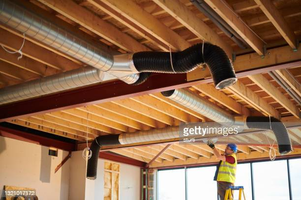 air conditioning duct install - sturti stock pictures, royalty-free photos & images