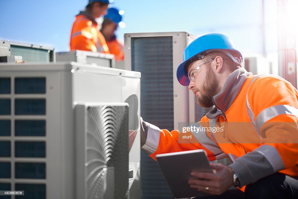 air conditioning engineer : Stock Photo