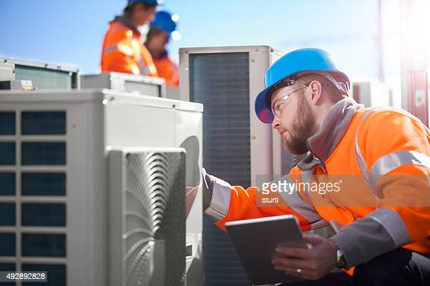 air conditioning engineer - ventilator stock pictures, royalty-free photos & images