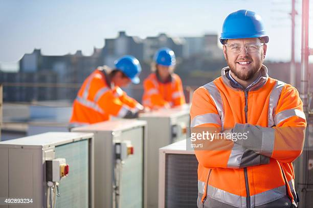 air conditioning engineer portrait - protective workwear stock pictures, royalty-free photos & images