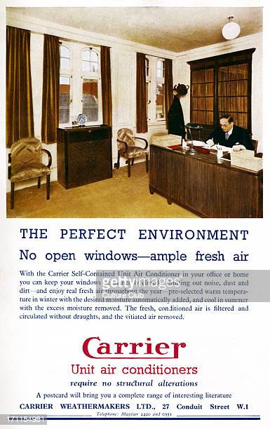 Air conditioning in the workplace - man seated at his desk in the office. 'Carrier' advert from programme of the Royal Opera' s 'Coronation Season',...