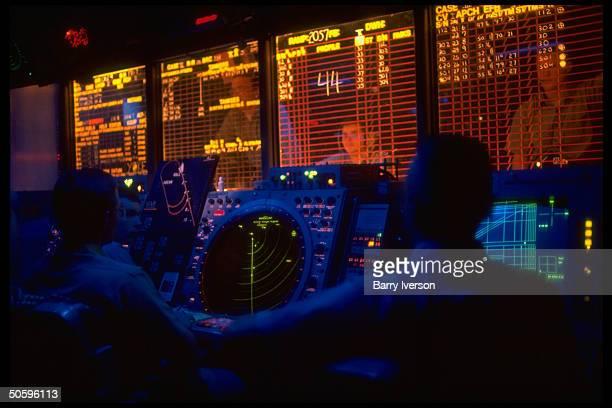 Air control ops rm strategy crew working w radar screens on bd carrier USS Kitty Hawk during USled air raid on Iraq enforcing UN postGulf War...