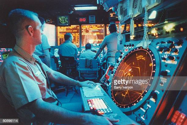 Air control ops rm. Strategy crew working w. Radar screens on bd. Carrier USS Kitty Hawk during US-led air raid on Iraq, mission enforcing UN...