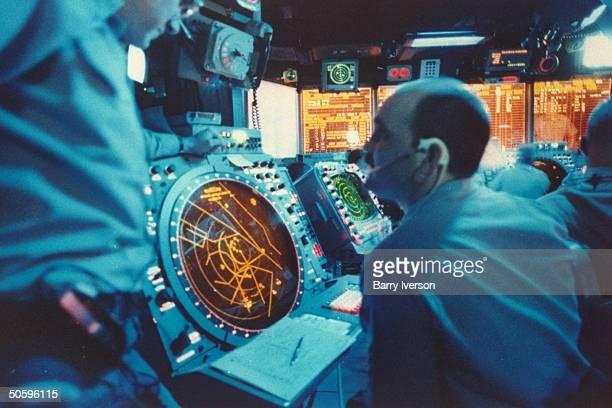 Air control ops rm strategy crew working w radar screens on bd carrier USS Kitty Hawk during USled air raid on Iraq mission enforcing UN postGulf War...