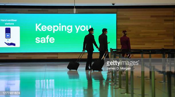 Air crew from Qatar Airways flight number QR909 arrive at Sydney International Airport on September 29 2020 in Sydney Australia The crew were...