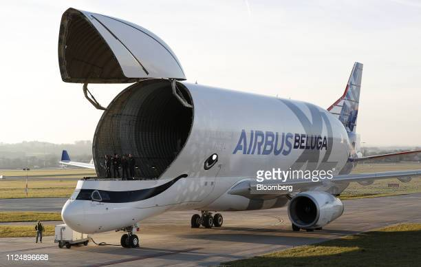 Air crew members stand inside an Airbus BelugaXL supertransporter aircraft after landing at Hawarden Airport near the Airbus SE plant in Broughton UK...