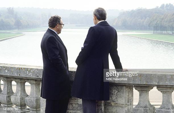 Air Date -- Pictured: U.S. Secretary of State Henry Kissinger, NBC News' David Brinkley at Versailles, France during an NBC News Special that...