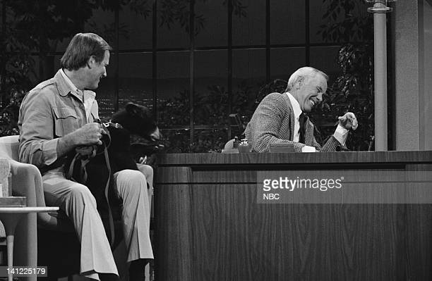 CARSON Air Date Pictured Zoologist Jim Fowler host Johnny Carson with a baby black bear Photo by Ron Tom/NBCU Photo Bank