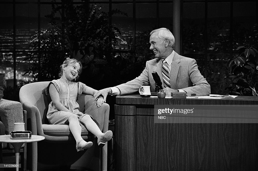 CARSON -- Air Date -- Pictured: (l-r) Actress Drew Barrymore, host Johnny Carson -- Photo by: Gene Arias/NBCU Photo Bank