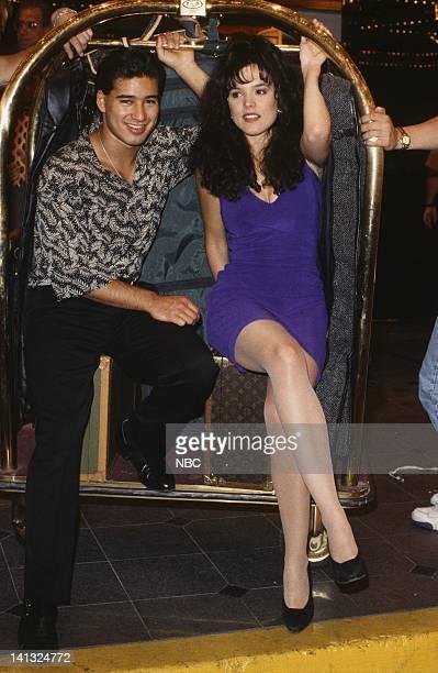 Mario Lopez as AC Slater Liz Vassey as Carla Photo by Gary Null/NBCU Photo Bank