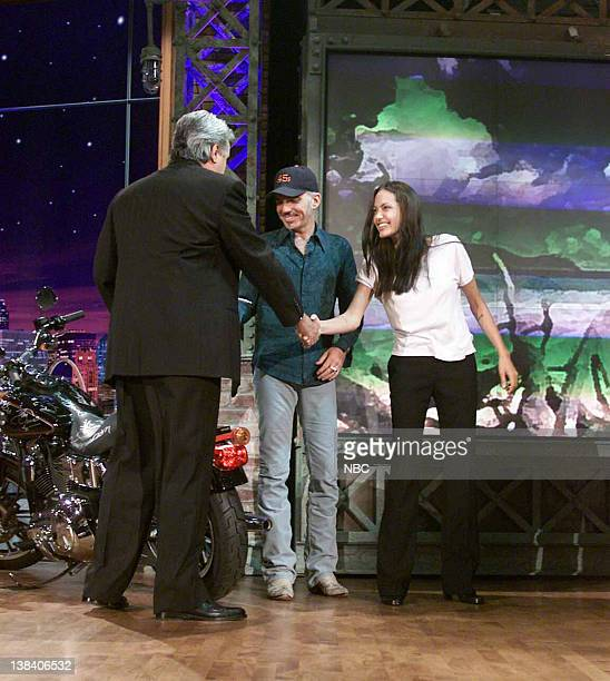 LENO Air Date Episode 2138 Pictured Host Jay Leno watches as actor Billy Bob Thornton and wife actress Angelina Jolie autography a motorcycle for...