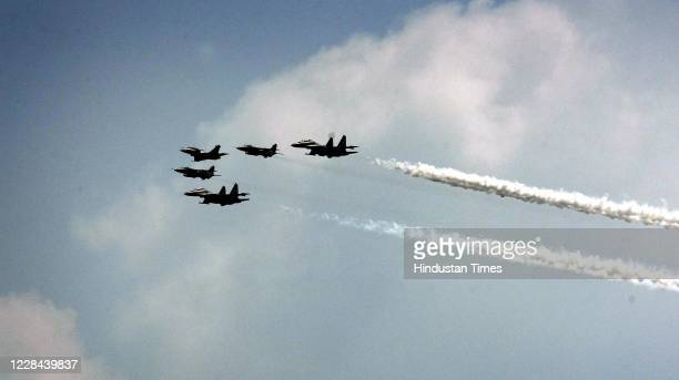 Air display of the first batch of IAFs Rafale aircraft in an arrow formation followed by Jaguar and SU-30 aircraft during the formers induction...