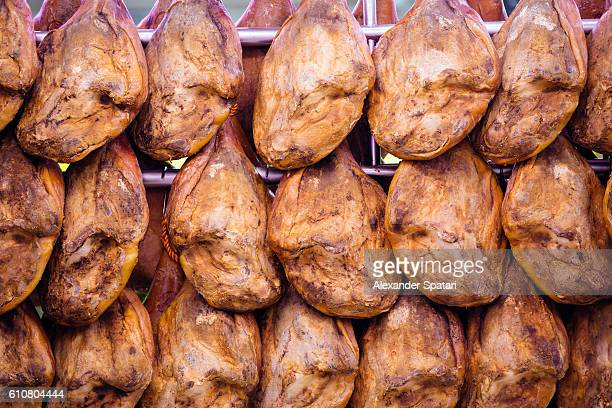 Air dried hams (jamon) hanging in the Mercado Central (Central Market), Valencia, Spain