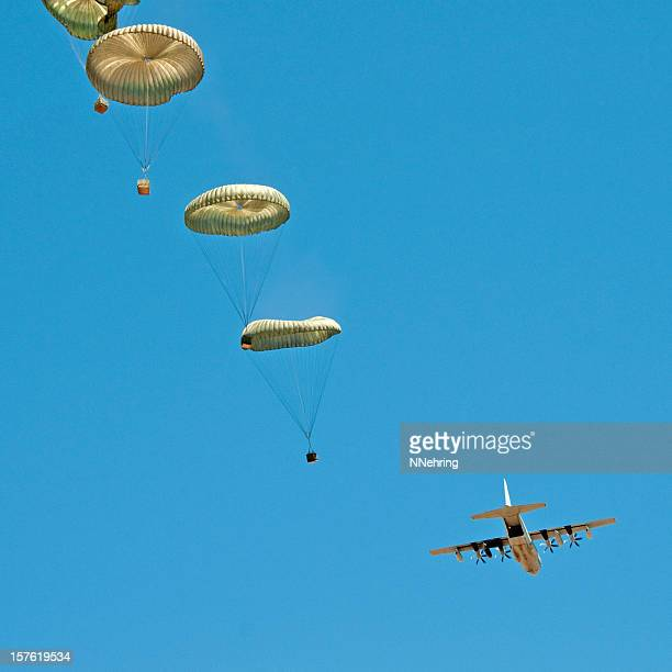 air drop from c130 airplane - cargo airplane stock photos and pictures