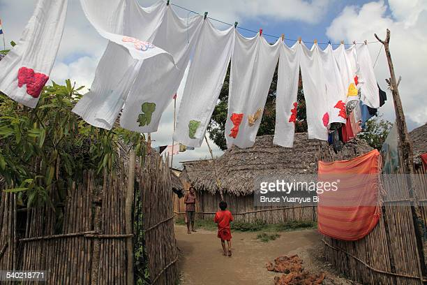 Air drying cloth diapers hanging over village road