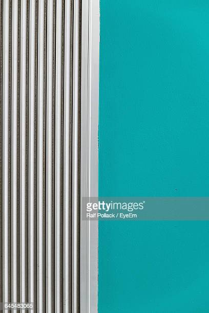 Air Duct On Turquoise Colored Wall