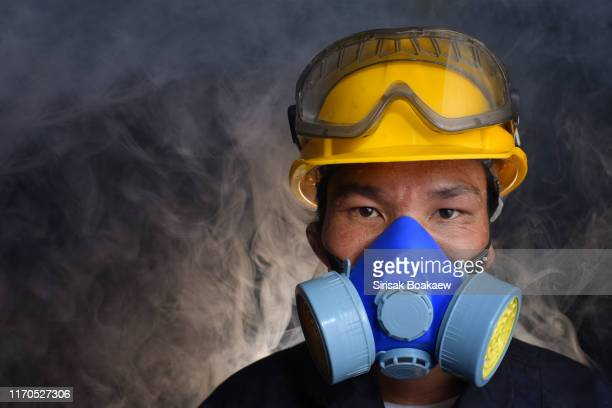 air filter masks for industrial applications that is poisoning - air respirator mask stock pictures, royalty-free photos & images