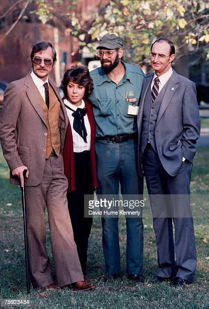 Air Florida Flight 90 crash survivors Joseph Stiley Patricia Felch Roger Olian and Bert Hamilton pose for a photo on November 15 1982 in Washington DC
