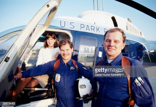 Air Florida Flight 90 survivor Kelly Duncan rescue team Pilot Donald Usher and Paramedic Melvin Windsor stand in front of a helicopter November 15...