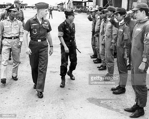 US Air Force 3rd Tactical Fighter Wing Commander Colonel Robert Ackerly escorts Republic of Vietnam Chief of State Nguyen Van Thieu on an inspection...